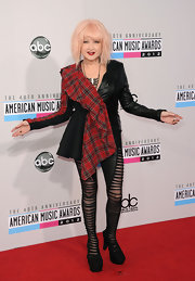 Cyndi's illusion tights looked extra-cool thanks to their sheer-and-shredded effect.