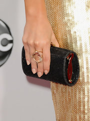 Elisha's glitzy clutch rounded out her shiny, sequined ensemble at the 2012 AMAs.