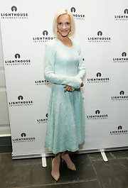 Lorry Newhouse chose a light sea foam long-sleeve dress with a full circle skirt for her look at 'A Posh Affair' gala in NYC.