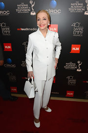 Anne Jeffreys looked sleek and sophisticated in this crisp white pantsuit.