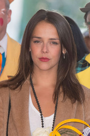 Pauline Ducruet wore her hair down to her shoulders in a straight center-parted style at the 40th International Circus Festival.