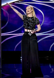 Iggy Azalea opted for a pair of black wide-leg pants to team with her embellished top.