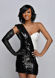 Keri makes a strong graphic statement in a sequin one-shoulder mini dress and a single opera-length glove.