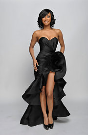 Va va voom! Keri shows off her gorgeous curves in a fabulously ruched and ruffled strapless evening gown.