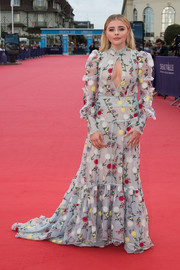 With its high neck, long sleeves, and floor-sweeping length, Chloe Grace Moretz's Erdem gown at the Deauville American Film Fest opening looked deceptively conservative--until you see that cleavage-baring cutout!