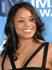 Connie opted for soft side swept curls while waking the carpet at the 42nd NAACP Awards.