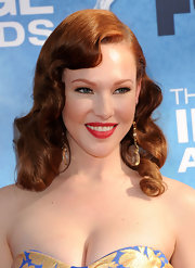 Erin Cummings channeled Old Hollywood glamour with deep parted waves. Her radiant red locks only added to the drama of her look.