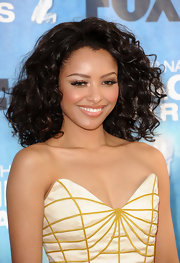 Kat Graham paired her plunging neckline with shoulder length curls. Added volume really gave her style an extra boost.