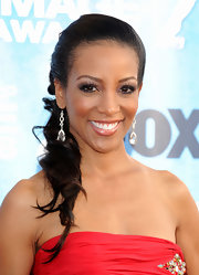 Shaun Robinson teamed her diamond drop earrings and strapless neckline with a curled ponytail.