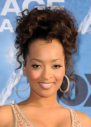 Jennia Fredrique pulled her hair up in a sleek ponytail at the 42nd Annual NAACP Image Awards.