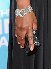 Angela Bassett wore a chain link bracelet with gemstone criss-cross design in the front.