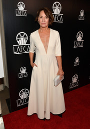 Laurie Metcalf donned a white Jill Stuart maxi dress with a plunging V neckline for the Los Angeles Film Critics Association Awards.