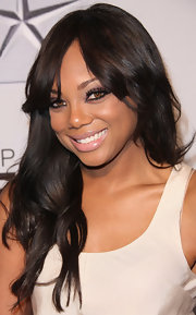 Tiffany Hines attended the 43rd NAACP Image Awards wearing a sheer shimmering pale pink lipstick.