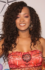 Jennia Fredrique wore her hair in voluminous curls at the 43rd NAACP Image Awards.