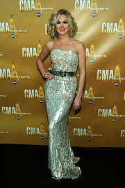 Singer and actress Laura Bell Bundy wore a one-of-a-kind gown as she walked down the black carpet of the 44th Annual CMA Awards. Laura opted for a full-length, fully hand-beaded silver gown from the recent Spring/Summer 2010 I Line collection.