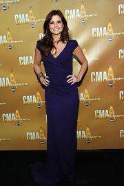 Joanna Garcia attended the 44th Annual Country Music Awards, wearing a curve hugging purple gown with subtle beaded embellishments. It looked absolutely stunning on the country cutie.