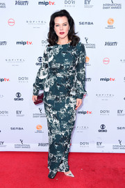 Debi Mazar attended the International Emmy Awards wearing a long-sleeve print gown.