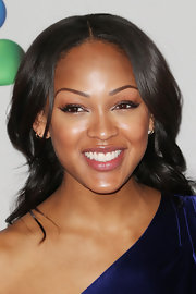 Meagan Good sported a sharp center part with loose waterfalls of waves at the 2013 NAACP Image Awards.