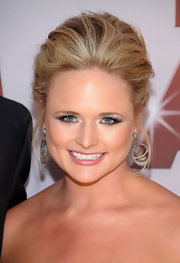 Miranda Lambert wore her blond tresses in a voluminous updo at the 45th Annual CMA Awards.
