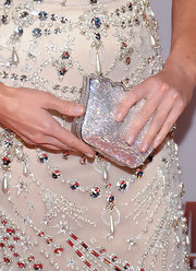Sandra Lee added shine to her bejeweled gown with a glistening silver box clutch with scalloped edges.