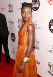 Lupita Nyong'o accessorized with a superhero-worthy H. Stern gold cuff during the NAACP Image Awards.