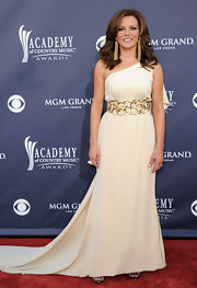 Martina looked breathtaking at the ACMAs in a dramatic one-shoulder evening gown with a gold sequined waistband.