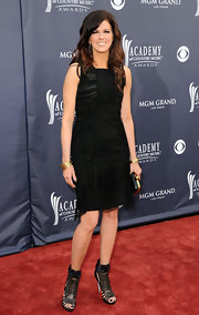 Karen modernized the LBD with some ruching and fringe. She topped off the look with gladiator sandals. Fierce!