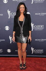 Sara covered her sparkling sequined cocktail dress with a sleek black blazer at the ACMAs.