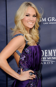 Carrie Underwood rocked long layered curls at the ACM Awards. While we love her look, a sleek updo may have suited her embellished dress better.