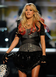 Carrie dazzled on stage in a mini dress topped off with blond tresses and pink streaks.