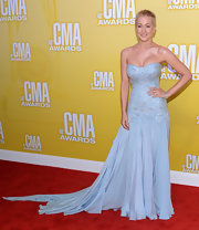 Remember when Kellie Pickler was super awesome and shaved her head for breast cancer awareness? Well, the blond beauty's locks may just be growing back, but she looks as fabulous as ever. We can't get over how glamorous this ice blue Pamella Roland gown was.