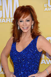 Reba's famous red hair is extra-layered to get country volume.