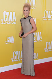 Kimberly Schlapman wore this light-catching column gown to the CMA Awards.