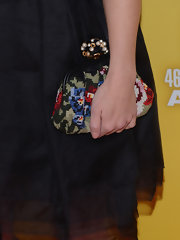 Kimberly's embroidered floral clutch provided her rocker-girl look with a touch of vintage glamour.