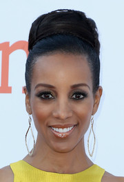 Shaun Robinson wore her hair up in a voluminous bun adorned with tiny braids during the NAACP Image Awards.