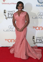 Uzo Aduba looked very ladylike in a gorgeous pink fishtail gown by Zac Posen during the NAACP Image Awards.