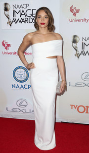 Carmen Ejogo looked very fashion-forward in an off-one-shoulder white cutout gown by Solace London during the NAACP Image Awards.