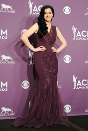 Shawna Thompson was a stunner in an oxblood lace mermaid gown at the Academy of Country Music Awards.