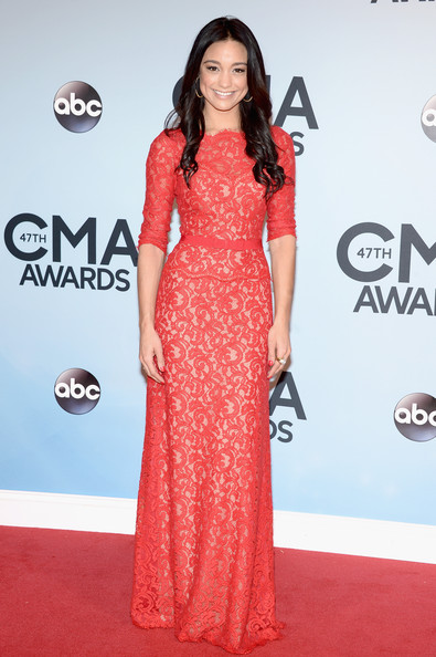 Rachel Smith was classic in a red lace gown by Tadashi Shoji during the CMA Awards.