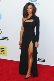 Serayah McNeill worked a Philipp Plein one-sleeve gown with a yoke cutout and a hip-grazing slit at the NAACP Image Awards.