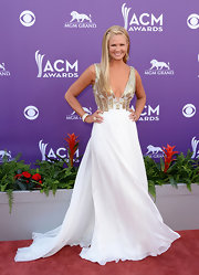 Nancy O'Dell chose an ethereal white gown with a gold embellished bodice that featured a deep V-neck.