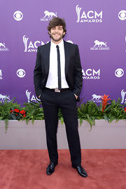 Thomas Rhett chose a classic black suit with a super skinny tie for his red carpet look at the 2013 ACMs.