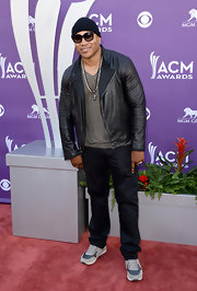 LL Cool J chose a black leather jacket to top off his cool and hip red carpet look.