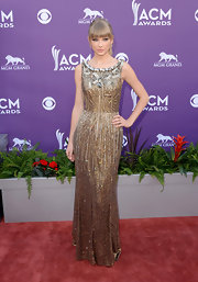 Taylor Swift simply dazzled in this column-style beaded gown that features crystal embellishments along the neckline.