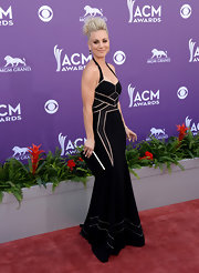 Kaley Cuoco stunned again in this black evening gown that featured geometric sheer panels.