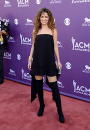 Shania Twain kept it simple on the red carpet with this black frock and matching thigh-high boots.