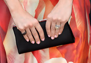 Carrie Underwood chose a simple black satin clutch to pair with her vibrant red carpet dress at the ACM Awards.