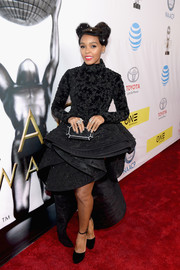 Janelle Monae teamed her glamorous dress with black ankle-strap platform pumps.