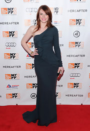 """Twilight"" actress Bryce Dallas Howard attended the premiere of her new movie, ""Hereafter"" in an Elie Saab Fall 2010 gown and a gold clutch."