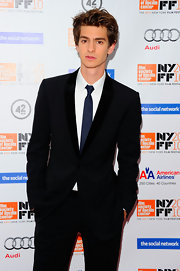 Andrew Garfield attended the premiere of 'The Social Network' at the 48th annual New York Film Festival wearing a black velvet trim tuxedo, white shirt and blue tie.